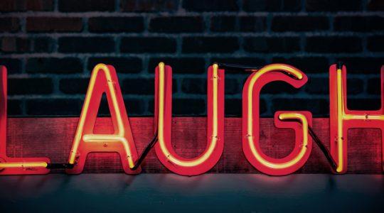 Neon orange Laugh sign